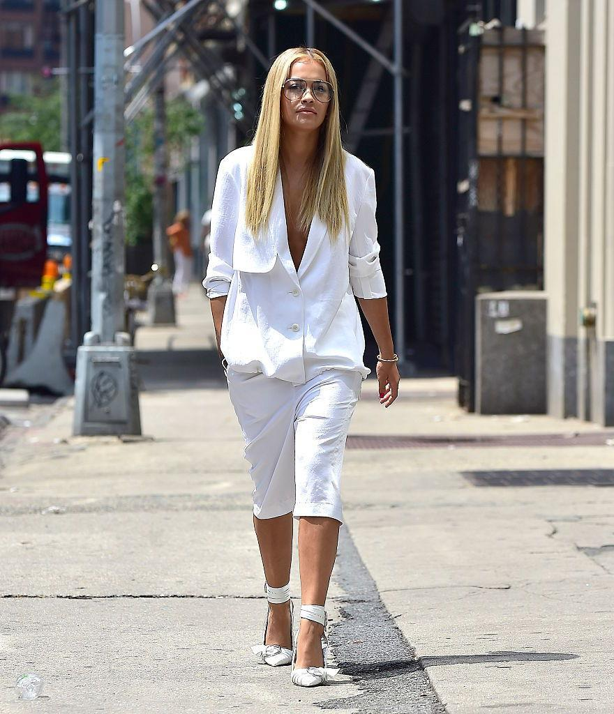<p>Looking effortless in an oversized white pantsuit with white pumps and slick, straight hair. <i>(Photo by Alo Ceballos/GC Images)</i></p>