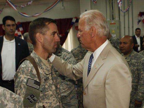 <p>Biden talks with his son, U.S. Army Capt. Beau Biden at Camp Victory on the outskirts of Baghdad on July 4, 2009. Biden said that America's role in Iraq was switching from deep military engagement to one of diplomatic support, ahead of a complete withdrawal from the country in 2011.</p>