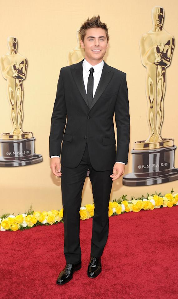 Zac Efron   Grade: A    It's easy to see why Zac had all the young ladies screaming at him from the red carpet bleachers.