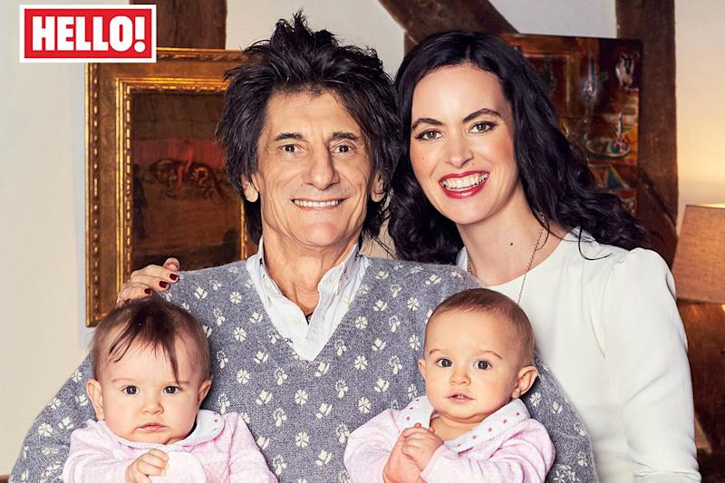 Proud parent: Ronnie and Sally Wood with their twin daughters: Hello!/ PA