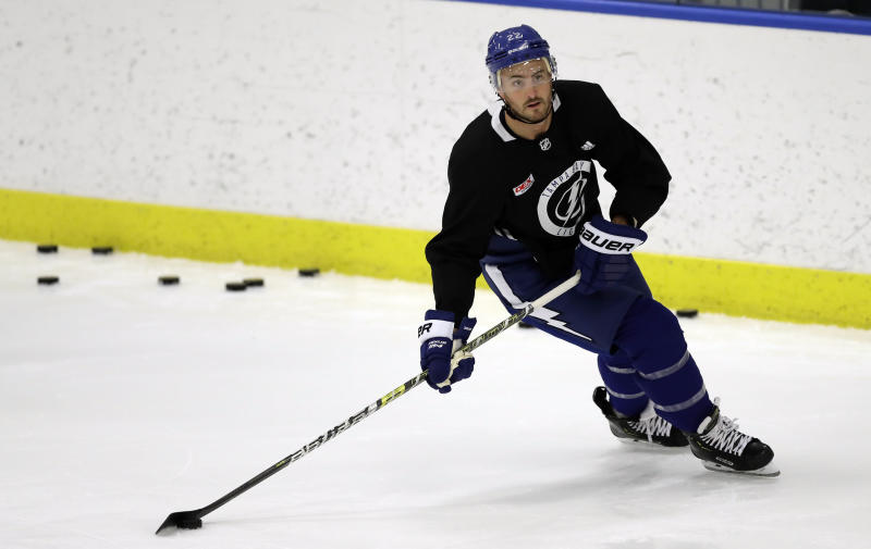 FILE - In this Sept. 13, 2019, file photo, Tampa Bay Lightning defenseman Kevin Shattenkirk (22) looks for an open teammate during the first day of NHL hockey training camp in Brandon, Fla. As NHL teams move toward paying their stars more money and relying on young players to fill the gaps, hockeys middle class is being squeezed out. Veterans like 2018 Washington Capitals playoff hero Devante Smith-Pelly are finding it increasingly difficult to land guaranteed contracts and are oftentimes forced to go to training camp on professional tryout agreements. Even more are settling for one-year, prove-it contracts like 2019 Cup winner Patrick Maroon and 30-year-old defenseman Kevin Shattenkirk with Tampa Bay. (AP Photo/Chris O'Meara, File)