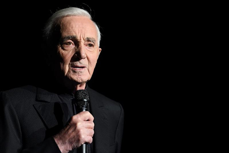 Charles Aznavour, one of France's greatest singer-songwriters, performing in Paris on December 13, 2017 (AFP Photo/Eric FEFERBERG)