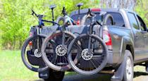 <p><strong>Hitch Racks </strong>are the most convenient of the types of racks listed here. They eliminate the need to lift bikes overhead, and once they're installed, they can stay put. Most hitch racks today lock to your receiver and are hinged so they can be folded up and out of the way when not in use. Modern hitch racks are also more jiggle-free than they once were, thanks to cams that be tightened inside your hitch's receiver. Most are compatible with 1¼-inch and 2-inch hitch systems, and many have integrated locks with cables to secure your bike to the rack. They're typically the most expensive of the bunch, but their convenience and security are well worth the investment.</p><p><strong>Roof Racks </strong>attach to your vehicle one of three ways: as a complete system that mounts to your car's roof, as trays that attach to your car's factory-installed roof rack, and in the form of suction cups, which vacuum-seal to most surfaces. A roof rack secures your bike one of two ways: with or without the front wheel attached. If you opt for a rack that requires removing the front wheel, make sure it's compatible with your bike's fork, especially if the fork has a thru-axle. The biggest factors to consider with roof racks is the height of your vehicle and the weight of your bike. If you have a heavy e-bike or an SUV, don't get a roof rack. If you find a roof rack that fits your vehicle and bike, remember that it's up there—the last thing you want to do is pull into a parking garage without enough clearance (believe me, I know). Generally, you can feel confident locking your bike to the rack with a cable lock.</p><p><strong>Trunk Racks </strong>can be a smart option if you're transporting one or two bikes, don't need a rack on your car all the time, or if budget is a primary concern. The trunk rack will attach to the back of your car using straps and hooks. But because trunk racks are temporary, you can't lock your bike to your car. There's also more potential to scratch
