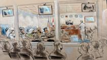 This courtroom sketch shows the media (bottom L) and victims' family members (bottom R) watching as accused September 11 mastermind Khalid Sheikh Mohammed (C) and co-defendents appear for a pretrial hearing in Guantanamo, Cuba on September 7, 2021 (AFP/William J. HENNESSY)