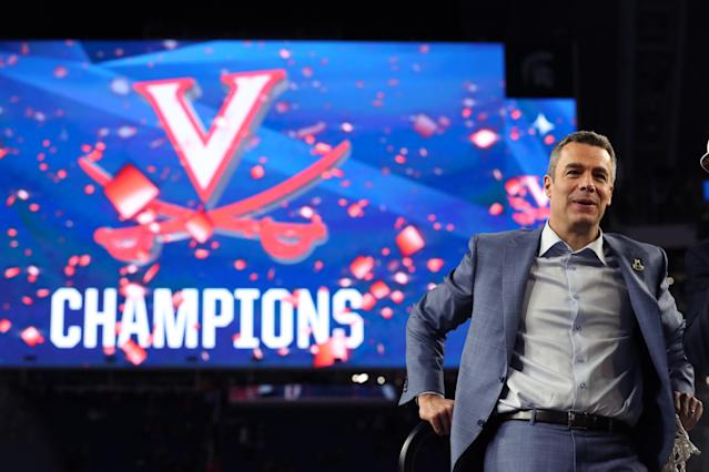 Head coach Tony Bennett of the Virginia Cavaliers celebrates with his team after the 85-77 win over the Texas Tech Red Raiders in the 2019 NCAA men's Final Four National Championship game at U.S. Bank Stadium on April 08, 2019 in Minneapolis, Minnesota. (Photo by Tom Pennington/Getty Images)