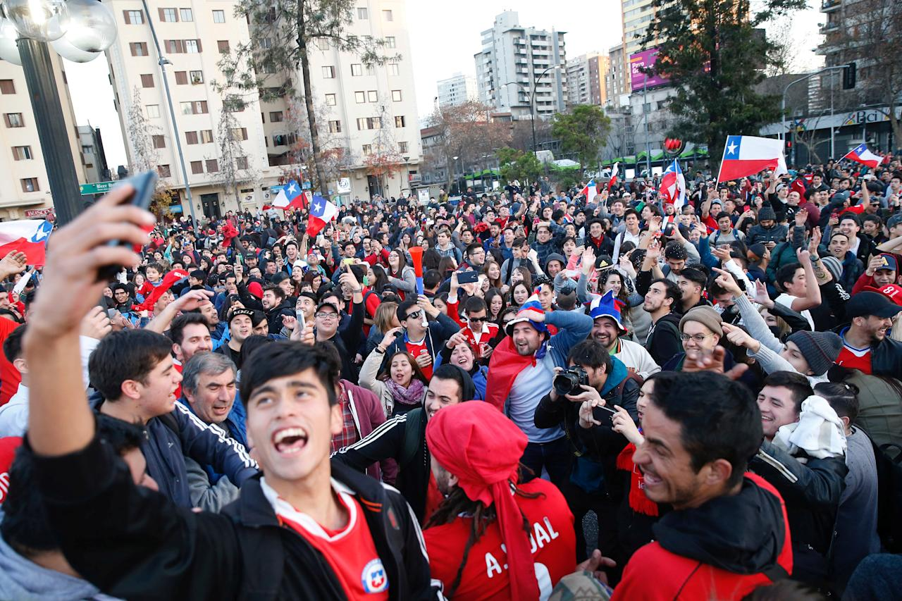 Chilean fans celebrate Chile's victory over Portugal during the Confederations Cup semi-final soccer match, in Santiago, Chile June 28, 2017. REUTERS/Rodrigo Garrido