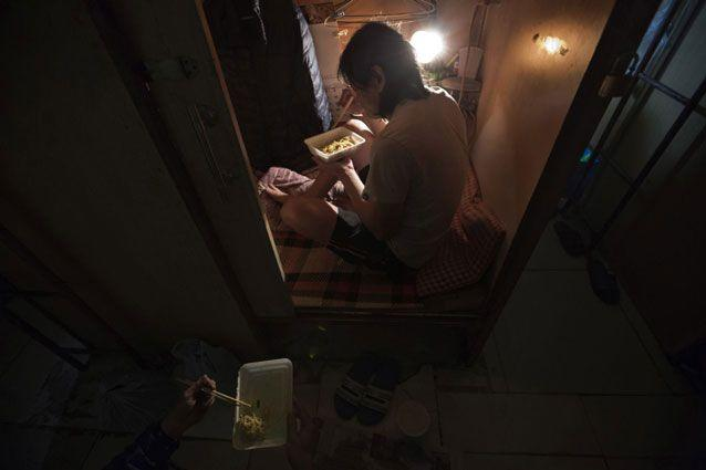 A resident who only gave his surname Lui, has dinner. Photo: AP
