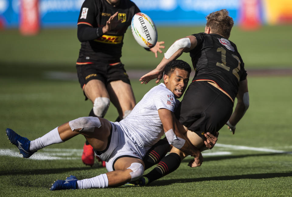 Jack Wendling, front left, of the United States, tackles Germany's Tim Lichtenberg, right, during an HSBC Canada Sevens fifth-place playoff rugby match in Edmonton, Alberta, Sunday, Sept. 26, 2021. (Jason Franson/The Canadian Press via AP)
