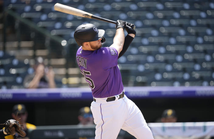 Colorado Rockies' C.J. Cron connects for a solo home run off Pittsburgh Pirates starting pitcher Chad Kuhl in the fourth inning of a baseball game Wednesday, June 30, 2021, in Denver. (AP Photo/David Zalubowski)