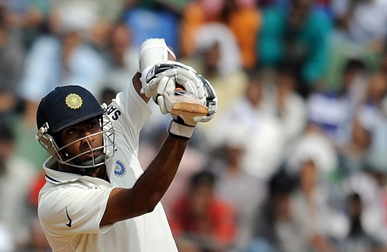 Indian batsman Ravichandran Ashwin plays a shot during the fourth day's play of the third Test cricket match between India and West Indies at The Wankhede Stadium in Mumbai on November 25, 2011.   AFP PHOTO/Punit PARANJPE