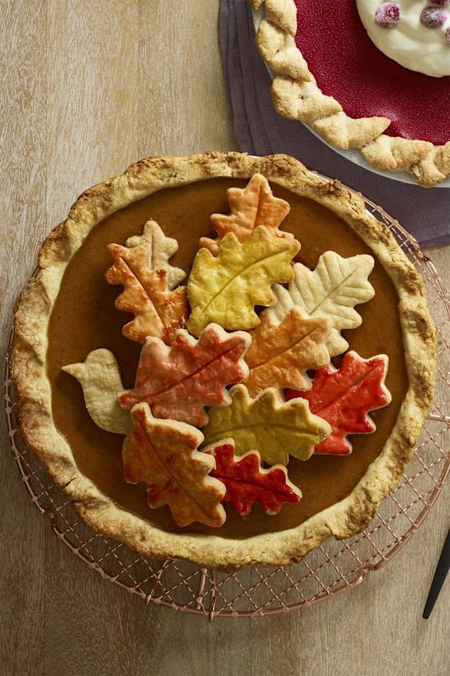 "<p>The turkey and autumn leaf-shaped pie crust on top of this dessert will make it the star of the spread.</p><p><strong><a rel=""nofollow"" href=""https://www.womansday.com/food-recipes/food-drinks/recipes/a60507/chai-pumpkin-pie-recipe/"">Get the recipe. </a></strong></p>"