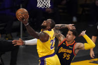 Los Angeles Lakers forward LeBron James, left, shoots as Golden State Warriors forward Juan Toscano-Anderson defends during the first half of an NBA basketball Western Conference Play-In game Wednesday, May 19, 2021, in Los Angeles. (AP Photo/Mark J. Terrill)