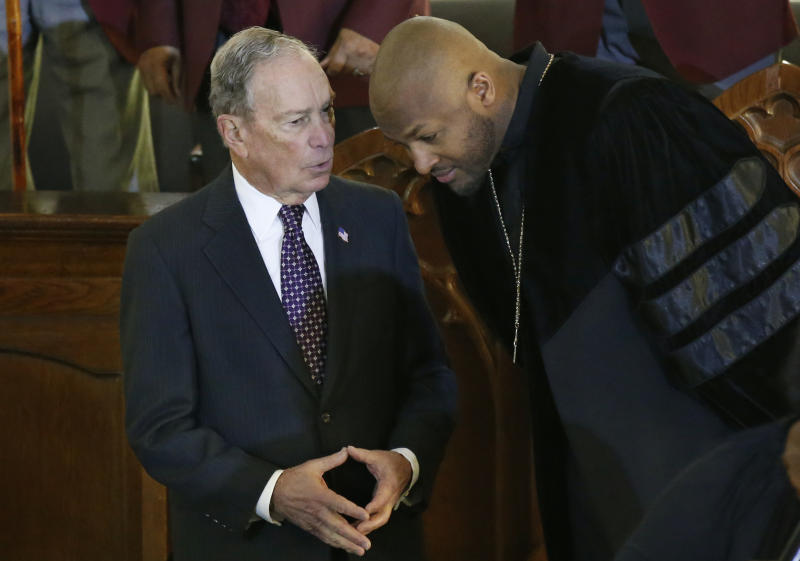 Democratic Presidential candidate Michael Bloomberg, left, talks with the Rev. Robert Turner, right, during a service at the Vernon American Methodist Episcopal Church in Tulsa, Okla., Sunday, Jan. 19, 2020. (AP Photo/Sue Ogrocki)