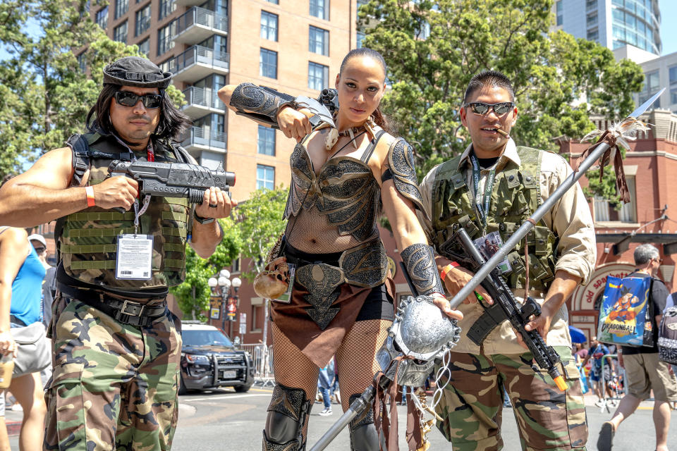 <p>Cosplayers dressed as Machiko, Dutch, and Billy of <em>Predator</em> at Comic-Con International on July 19, 2018, in San Diego. (Photo: Christy Radecic/Invision/AP) </p>