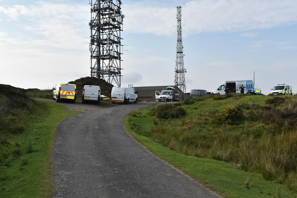 Police officers at the scene near the summit of Brown Clee Hill in south Shropshire. A murder investigation has been launched after a pensioner was found dead in the area.