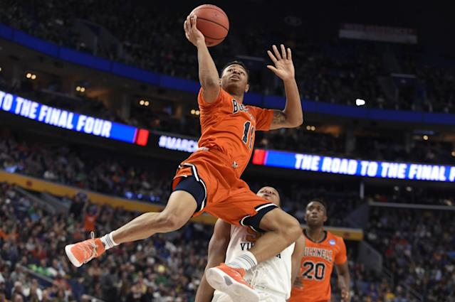 <p>Bucknell Bison guard Avi Toomer (11) shoots a layup against the West Virginia Mountaineers in the first half during the first round of the NCAA Tournament at KeyBank Center. Mandatory Credit: Mark Konezny-USA TODAY Sports </p>