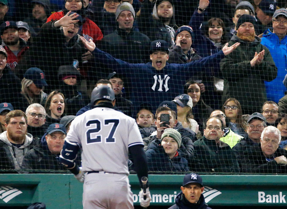 New York Yankees' Giancarlo Stanton walks to the dugout after striking out during the third inning of a baseball game against the Boston Red Sox in Boston, Tuesday, April 10, 2018. (AP Photo/Michael Dwyer)