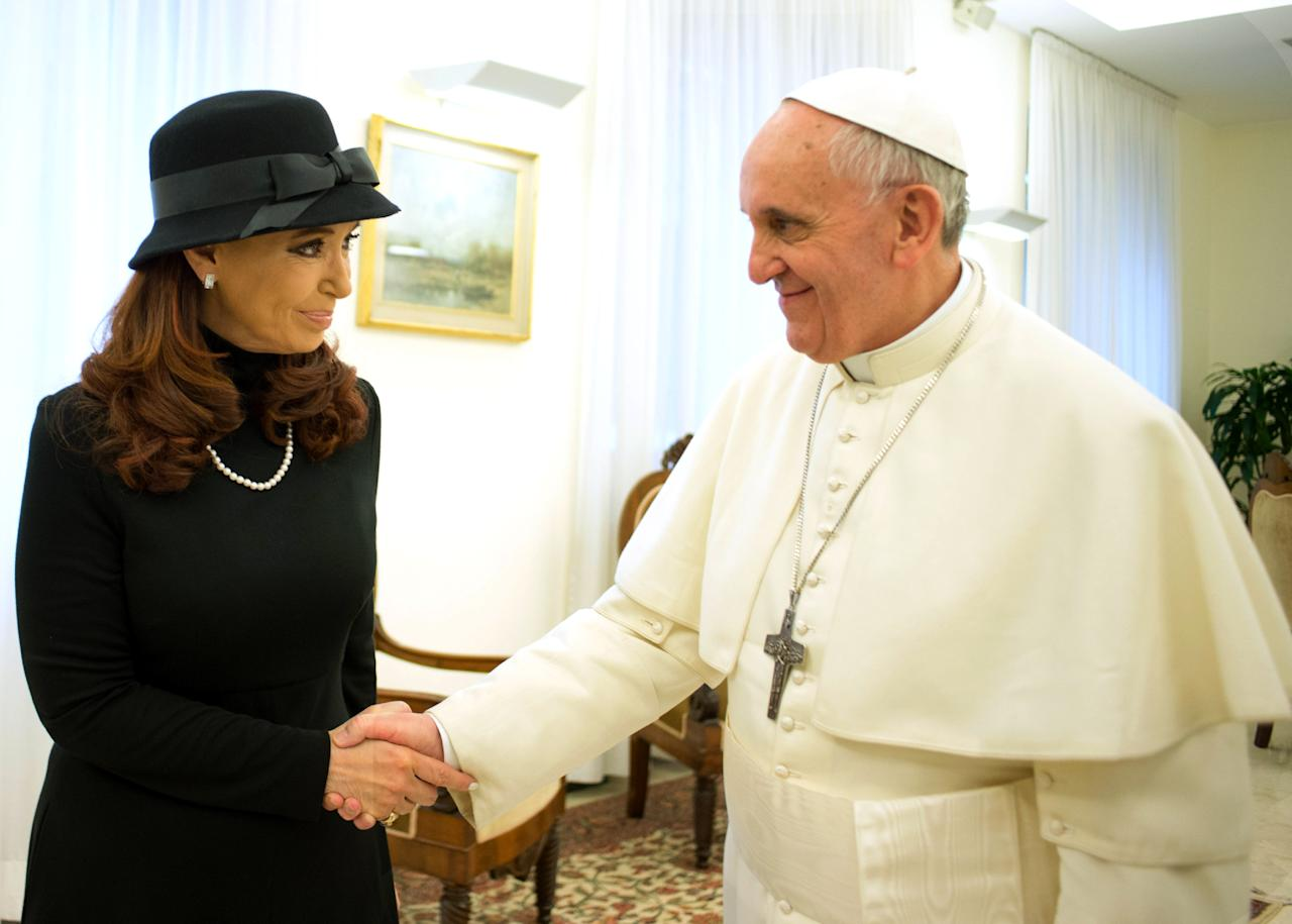 In this photo provided by the Vatican paper L'Osservatore Romano, Pope Francis meets Argentine President Cristina Fernandez at the Vatican, Monday, March 18, 2013. Pope Francis' diplomatic skills were put to the test Monday as he met with Argentine President Cristina Fernandez, with whom he has clashed over her socially liberal policies and what he has called the government's totalitarianism. Fernandez called on the former Archbishop of Buenos Aires Monday at his temporary home, the Vatican hotel on the edge of the Vatican gardens, and the two later lunched together, a day before she and other world leaders attend his installation Mass in St. Peter's Square that some estimates say could bring 1 million people to Rome. (AP Photo/L'Osservatore Romano)