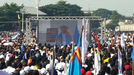 FILE PHOTO: Supporters of Congolese exiled opposition leader Moise Katumbi gather to watch his address via a video link in Kinshasa