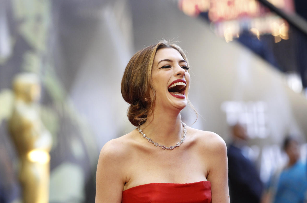 Actress and co-host Anne Hathaway laughs as she arrives at the 83rd Academy Awards in Hollywood, California, February 27, 2011. Hathaway's diamond necklace is by Tiffany and Co.   REUTERS/Mario Anzuoni (UNITED STATES - Tags: ENTERTAINMENT) (OSCARS-ARRIVALS)