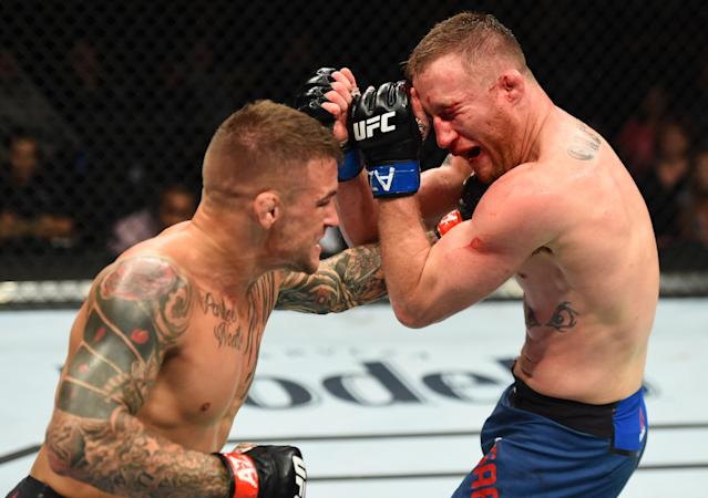 Dustin Poirier (L) punches Justin Gaethje in their lightweight fight during the UFC Fight Night event at the Gila Rivera Arena on April 14, 2018 in Glendale, Arizona. (Getty Images)