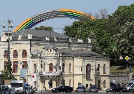 "A Soviet monument, ""Arch of the Friendship of Nations"", painted with rainbow colours, in celebration of diversity ahead of the Eurovision Song Contest, is seen in central Kiev, Ukraine May 4, 2017. REUTERS/Gleb Garanich"