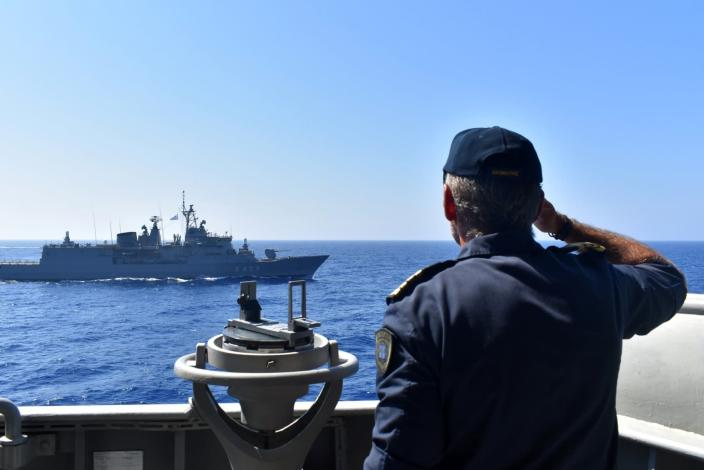 In this photo provided by the Greek Defense Ministry, warships take part in a military exercise in Eastern Mediterranean sea, Tuesday, Aug. 25, 2020. Turkey is accusing France of stoking tensions in the eastern Mediterranean, where NATO allies Turkey and Greece are locked in a stiff standoff over competing claims over offshore energy exploration rights. The accusation came as European Union foreign ministers are set to meet on Thursday, Aug. 27, 2020 to persuade the two to pull back from the brink of a conflict. (Greek Defense Ministry via AP)
