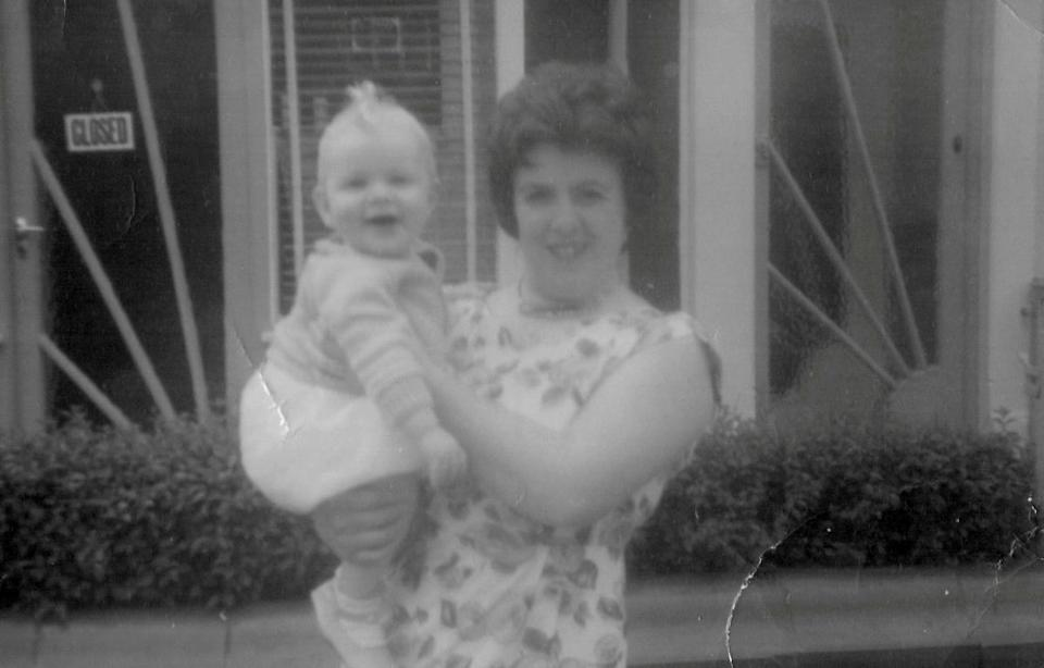 Margaret Sherlock with Adrian as a baby outside the shop in 1963. (SWNS)