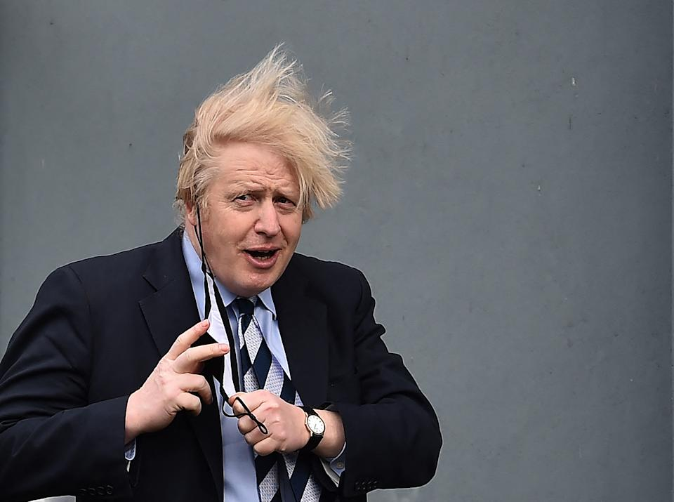 Britain's Prime Minister Boris Johnson leaves after visiting the Lakeland Forum Covid-19 vaccination centre on March 12, 2021 in Enniskillen, Northern Ireland. (Photo by Charles McQuillan / POOL / AFP) (Photo by CHARLES MCQUILLAN/POOL/AFP via Getty Images)