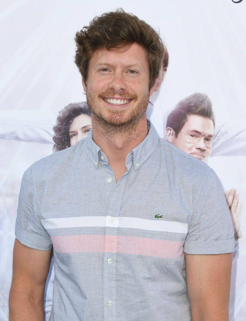 """<p>You might recognise Anders Holm from his role as Casey in The Mindy Project, as well as playing Anders Holmvik in Workaholics. He's starring as Vivian's husband Jack in Inventing Anna who, while supportive, begins to find things harder as he watches Vivian becoming more in danger of succumbing to her obsession with the heiress. <br></p><p>While Jessica Pressler is married in real life, it's not known whether Jack is based on her real-life husband, or whether he's fictionalised too. <br><br><strong>Cosmopolitan UK's current issue is out now and you can </strong><a href=""""https://www.hearstmagazines.co.uk/cosmopolitan-magazine-subscription-website?utm_source=cosmopolitan.co.uk&utm_medium=referral&utm_content=article"""" rel=""""nofollow noopener"""" target=""""_blank"""" data-ylk=""""slk:SUBSCRIBE HERE"""" class=""""link rapid-noclick-resp""""><strong>SUBSCRIBE HERE</strong></a><strong>.</strong></p><p><br><strong>Like this article? </strong><a href=""""https://hearst.emsecure.net/optiext/optiextension.dll?ID=nPTl681bgeiKhoMTpW31pzPluR1KbK8iYdv56%2BzY5rdcCoNqPYqUsTx_%2BXEjZKPdzGeMe03lZk%2B1nA"""" rel=""""nofollow noopener"""" target=""""_blank"""" data-ylk=""""slk:Sign up to our newsletter"""" class=""""link rapid-noclick-resp""""><strong>Sign up to our newsletter</strong></a><strong> to get more articles like this delivered straight to your inbox.</strong><br><br></p>"""