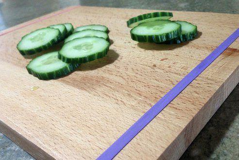 Stop your chopping board from shifting around by tying rubber bands around each end.