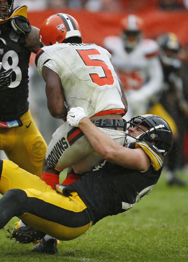 Pittsburgh Steelers linebacker T.J. Watt (90) sacks Cleveland Browns quarterback Tyrod Taylor (5) during the second half of an NFL football game, Sunday, Sept. 9, 2018, in Cleveland. (AP Photo/Ron Schwane)