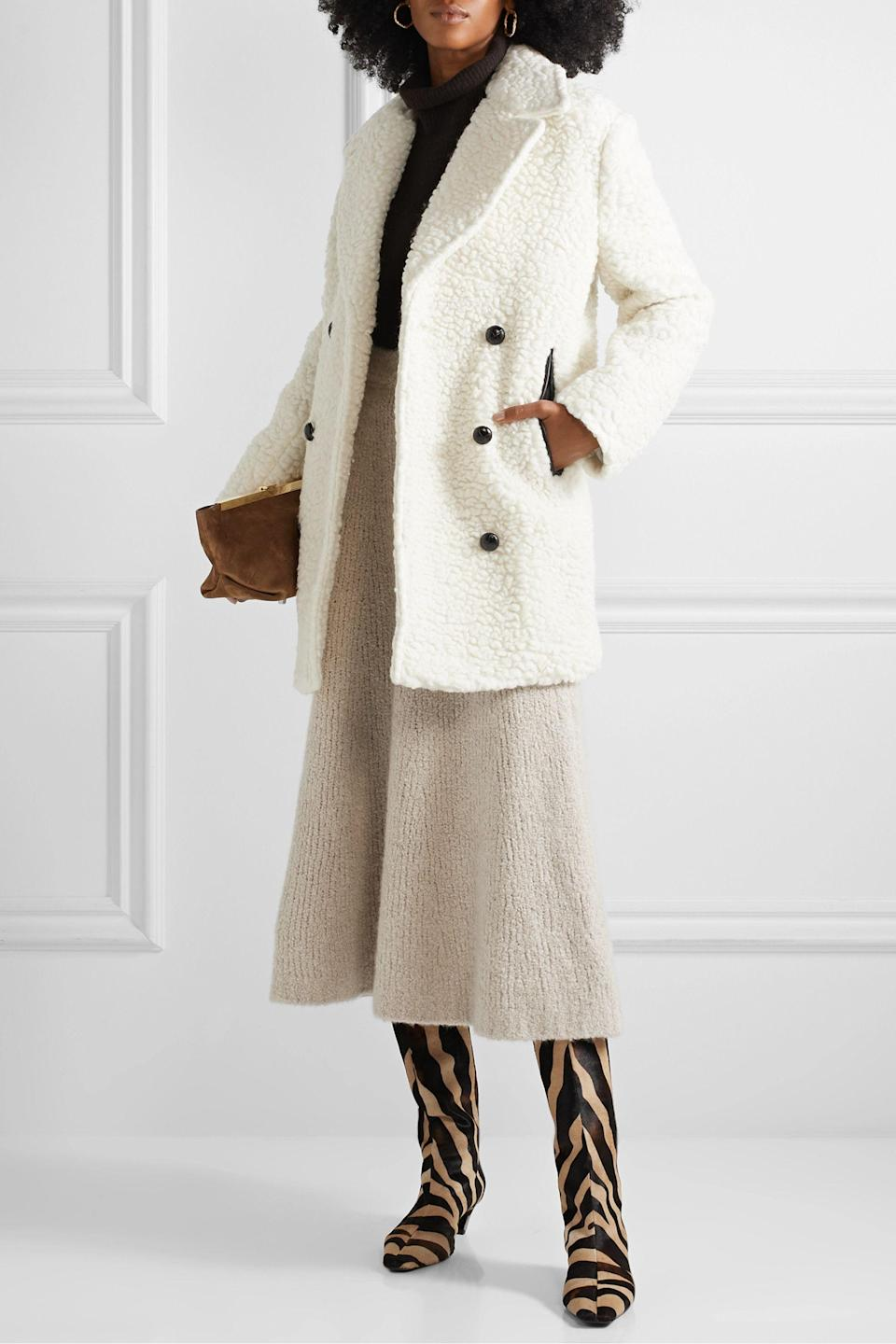 """<p><strong>BY MALENE BIRGER</strong></p><p>net-a-porter.com</p><p><strong>$447.50</strong></p><p><a href=""""https://go.redirectingat.com?id=74968X1596630&url=https%3A%2F%2Fwww.net-a-porter.com%2Fen-us%2Fshop%2Fproduct%2Fby-malene-birger%2Fclothing%2Fshort%2Fdouble-breasted-textured-wool-blend-coat%2F17957409491089013&sref=https%3A%2F%2Fwww.cosmopolitan.com%2Fstyle-beauty%2Ffashion%2Fg36618322%2Fnet-a-porter-spring-sale-2021%2F"""" rel=""""nofollow noopener"""" target=""""_blank"""" data-ylk=""""slk:Shop Now"""" class=""""link rapid-noclick-resp"""">Shop Now</a></p><p>Shopping hack for ya: Buy your winter coats in the summertime because they're, like, superrrr discounted. Snag this white beaut that'll match allll the 'fits.</p>"""