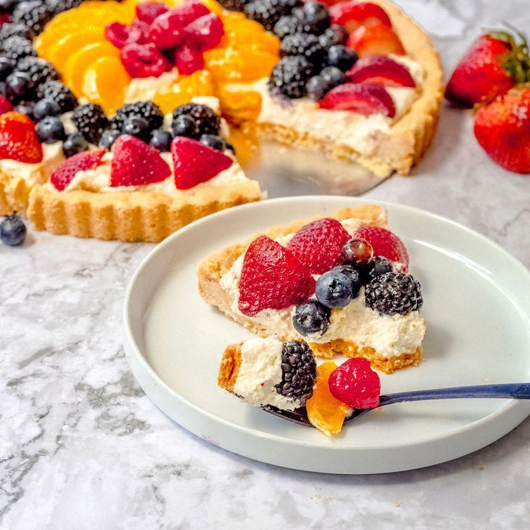 """<p>Highlight the season's best fruit by making this easy fruit tart. The shortbread-like crust is a press in crust, which makes it no-fuss and stress-free. Be sure to press it to the top of your tart pan because it shrinks as it bakes. The filling is light, slightly tart, and just sweet enough.</p><p>Get the <a href=""""https://www.delish.com/uk/cooking/recipes/a33119624/fruit-tart-recipe/"""" rel=""""nofollow noopener"""" target=""""_blank"""" data-ylk=""""slk:Fruit Tart"""" class=""""link rapid-noclick-resp"""">Fruit Tart</a> recipe.</p>"""