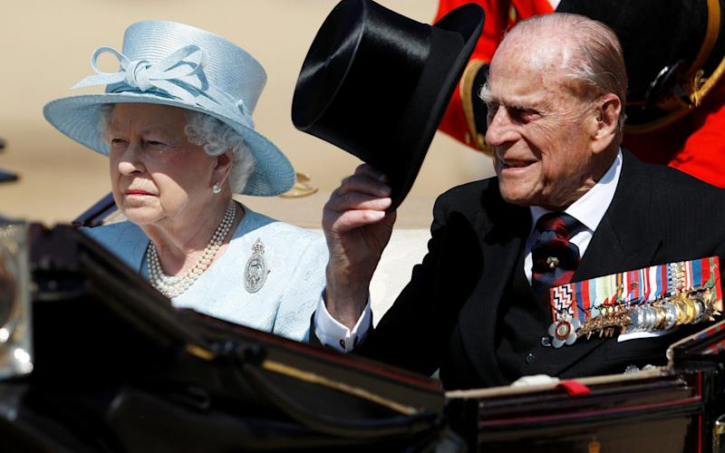 Queen Elizabeth II and Prince Philip, Duke of Edinburgh, travel in the royal carriage during the annual Trooping the Colour parade - Credit: Reuters
