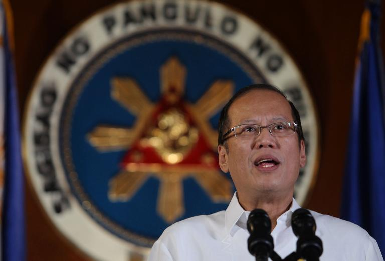 Philippine President Benigno Aquino delivers an address to the nation on live television broadcast from Malacanang Palace in Manila, on October 30, 2013