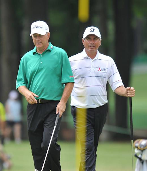 Jay Hass,left, and Fred Couples walk to their shots on the ninth green during the first round of the Regions Tradition golf tournament at Shoal Creek Country Club in Brimingham, Ala., Thursday, June 6, 2013. (AP Photo/AL.com, Frank Couch) MAGS OUT