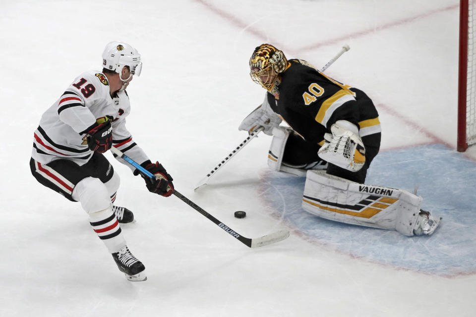 Chicago Blackhawks center Jonathan Toews (19) scores a game-winning goal on a breakaway against Boston Bruins goaltender Tuukka Rask (40) in the overtime period of an NHL hockey game, Thursday, Dec. 5, 2019, in Boston. The Blackhawks won 4-3 in overtime. (AP Photo/Elise Amendola)
