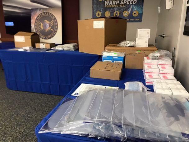 PHOTO: Ancillary kits containing needles, syringes, face screens, masks, and other materials that will be sent with the Pfizer and Moderna coronavirus vaccines to administration sites are displayed at Operation Warp Speed headquarters. (Luis Martinez/ABC News)