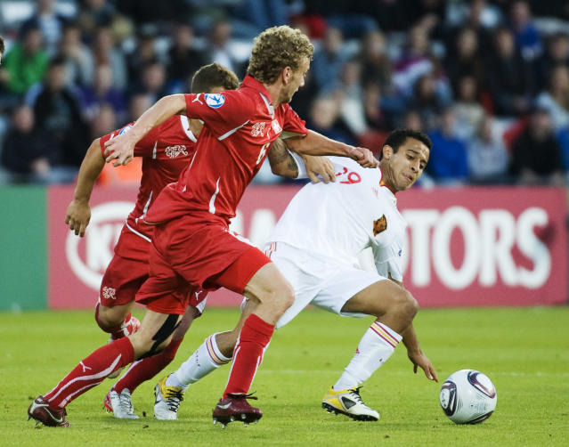 Thiago Alcantara of Spain (R) vies with Switzerland's Fabian Lustenberger (L) during the UEFA Under-21 European Championship final football match Spain vs Switzerland at the Aarhus Stadium, on June 25, 2011. AFP PHOTO/JONATHAN NACKSTRAND (Photo credit should read JONATHAN NACKSTRAND/AFP/Getty Images)
