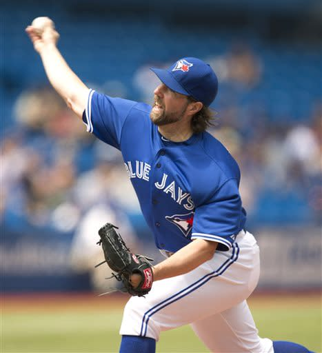 Toronto Blue Jays pitcher R.A. Dickey throws to a Minnesota Twins batter during the first inning of a baseball game in Toronto on Saturday, July 6, 2013. (AP Photo/The Canadian Press, Frank Gunn)