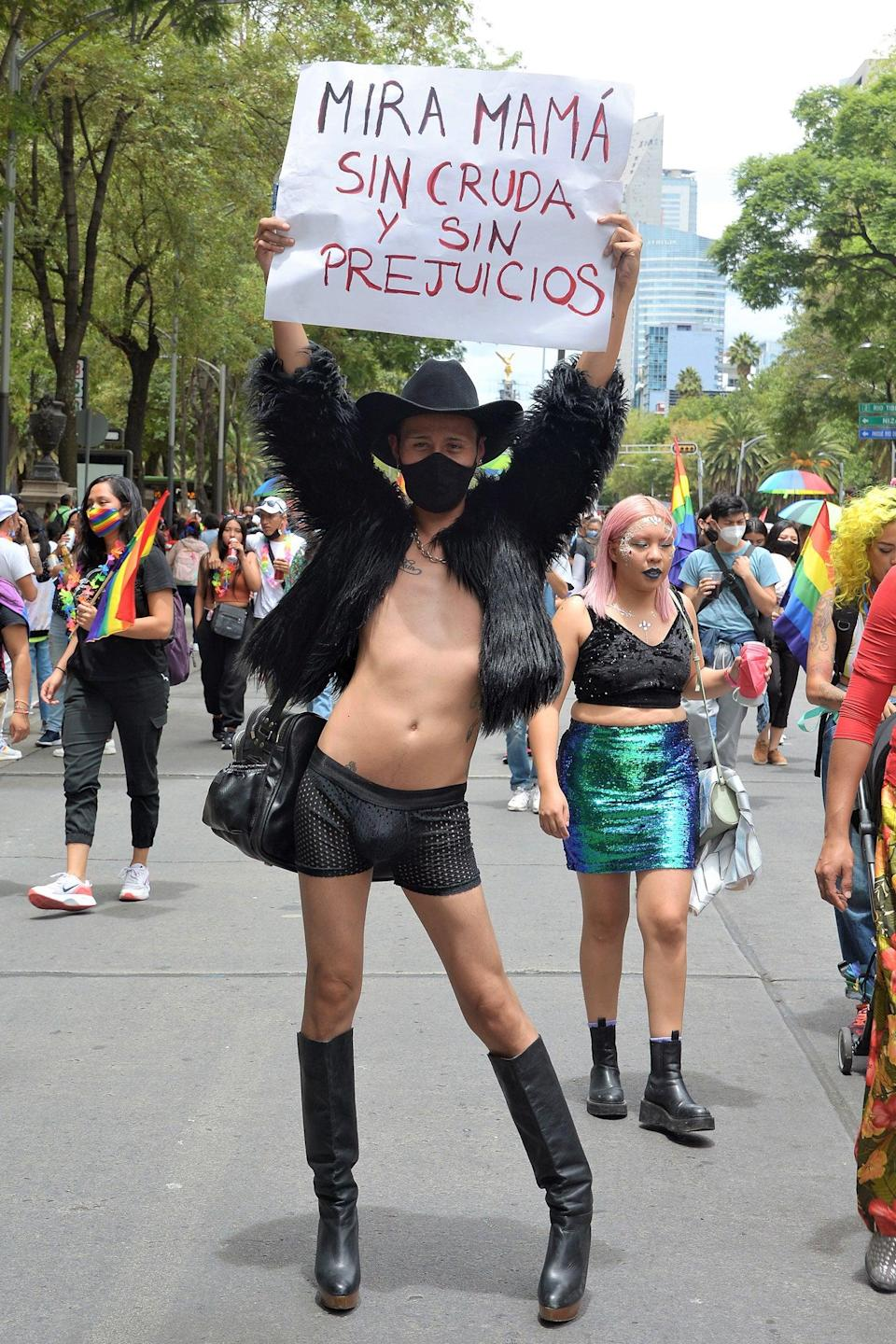 """Always wear your politics and your boots with pride like this parade-goer in Mexico City. <span class=""""copyright"""">Photo: Medios y Media/Getty Images.</span>"""