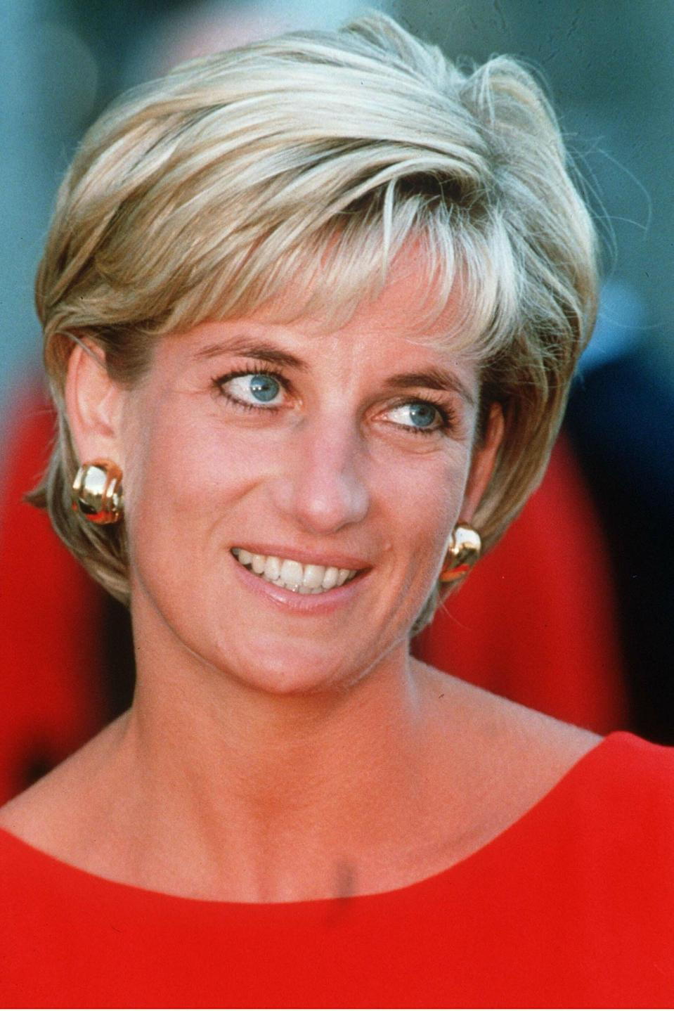 <p>Her last engagement in Britain was at the North Park Children's A&E Unit on July 21st, 1997. For the occasion, Princess Diana donned a striking red shift dress and sported a shorter hairstyle with bangs. <em>[Photo: PA]</em> </p>