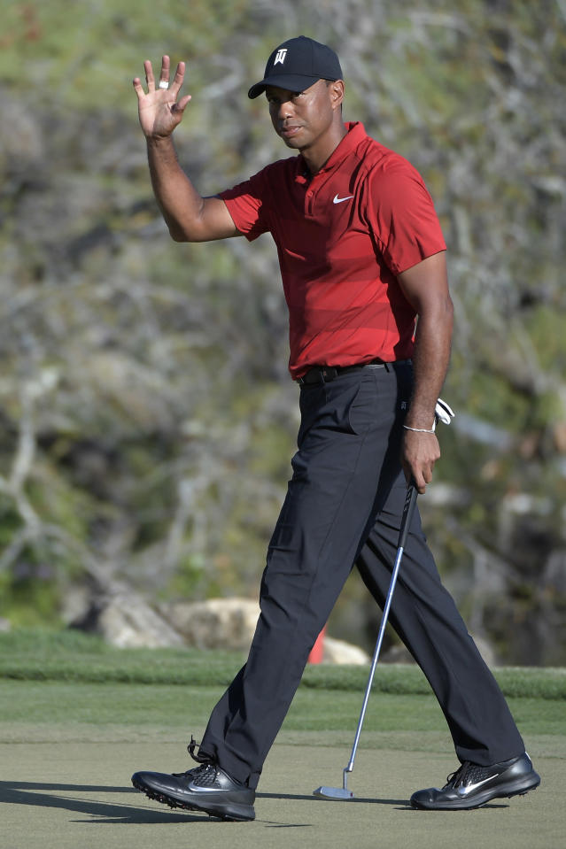 Tiger Woods acknowledges the crowd after making a putt on the 18th green during the final round of the Arnold Palmer Invitational golf tournament Sunday, March 18, 2018, in Orlando, Fla. (AP Photo/Phelan M. Ebenhack)