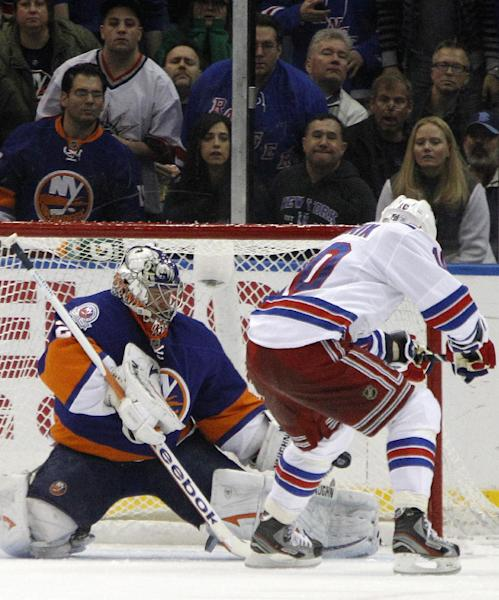 New York Rangers right wing Marian Gaborik (10) scores past New York Islanders goalie Evgeni Nabokov (20) in the second period of their NHL hockey game at Nassau Coliseum in Uniondale, N.Y., Friday, Feb. 24, 2012. (AP Photo/Kathy Willens)