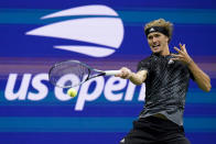 Alexander Zverev, of Germany, returns a shot to Jack Sock, of the United States, during the third round of the US Open tennis championships, Saturday, Sept. 4, 2021, in New York. (AP Photo/Frank Franklin II)