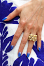 """<p>Pick a chic angular design that elongates the appearance of your nails, like this pointy <a href=""""https://www.goodhousekeeping.com/beauty/nails/how-to/a37010/reverse-french-manicure-tutorial/"""" rel=""""nofollow noopener"""" target=""""_blank"""" data-ylk=""""slk:half moon manicure"""" class=""""link rapid-noclick-resp"""">half moon manicure</a>.</p><p><a class=""""link rapid-noclick-resp"""" href=""""https://www.amazon.com/essie-nail-polish-aruba-sapphire/dp/B004FGAZNM?tag=syn-yahoo-20&ascsubtag=%5Bartid%7C10055.g.1278%5Bsrc%7Cyahoo-us"""" rel=""""nofollow noopener"""" target=""""_blank"""" data-ylk=""""slk:SHOP BLUE POLISH"""">SHOP BLUE POLISH</a></p><p><a href=""""https://www.instagram.com/p/3cq7IgmsJu/?taken-by=paintboxnails"""" rel=""""nofollow noopener"""" target=""""_blank"""" data-ylk=""""slk:See more on Paintbox Nails »"""" class=""""link rapid-noclick-resp""""><em>See more on Paintbox Nails »</em></a></p>"""