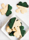 """<p>Keep it simple with these cute shamrock sugar cookies. Dip the corners in chocolate and decorate with green sprinkles.</p><p><strong>Get the recipe at <a href=""""https://www.ifyougiveablondeakitchen.com/shamrock-st-patricks-day-cookies/"""" rel=""""nofollow noopener"""" target=""""_blank"""" data-ylk=""""slk:If You Give a Blonde a Kitchen"""" class=""""link rapid-noclick-resp"""">If You Give a Blonde a Kitchen</a>.</strong></p><p><strong><a class=""""link rapid-noclick-resp"""" href=""""https://go.redirectingat.com?id=74968X1596630&url=https%3A%2F%2Fwww.walmart.com%2Fsearch%2F%3Fquery%3Dshamrock%2Bcookie%2Bcutter&sref=https%3A%2F%2Fwww.thepioneerwoman.com%2Ffood-cooking%2Fmeals-menus%2Fg35269814%2Fst-patricks-day-desserts%2F"""" rel=""""nofollow noopener"""" target=""""_blank"""" data-ylk=""""slk:SHOP SHAMROCK COOKIE CUTTERS"""">SHOP SHAMROCK COOKIE CUTTERS</a><br></strong></p>"""