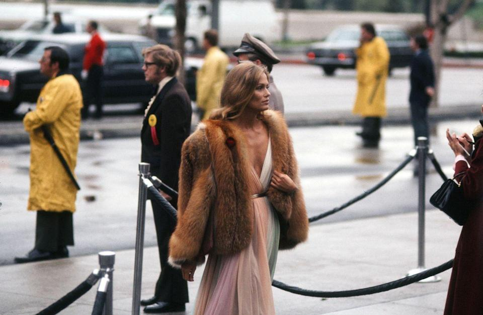 <p>The supermodel's Grecian-esque Halston gown, fur coat, and loose waves was a look fit for a princess at that year's ceremony. Although she was a presenter, her look is one of the most memorable in red carpet history. </p>