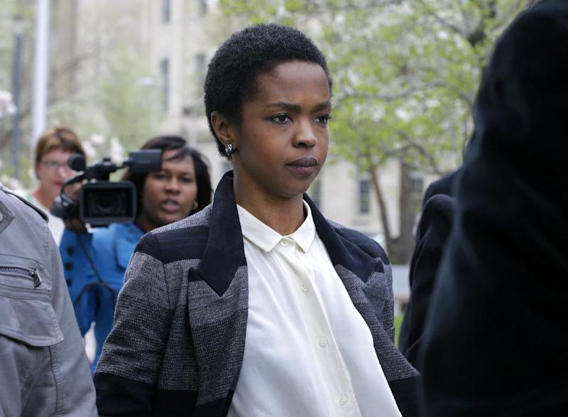 FILE - This April 22, 2013 file photo shows singer Lauryn Hill walking from federal court in Newark, N.J. Hill is facing sentencing Monday, May 6, on federal tax charges. Hill pleaded guilty last year to not paying federal taxes on $1.8 million earned from 2005 to 2007. A judge two weeks ago said Hill had paid only about $50,000 of more than $500,000 she owes. Hill said she has signed a recording contract with Sony that will help her pay her taxes. Citing the legal deadline, she made a song available on iTunes over the weekend. She faces up to a year in prison on each of three counts. Her attorney is seeking probation for her. (AP Photo/Mel Evans, file)
